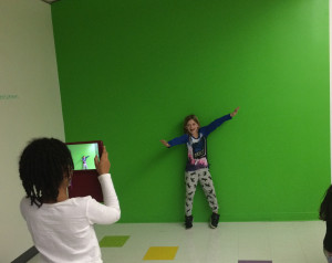 2nd graders, Milan B. and Lila B., work together to create green screen images