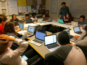 Alex Cussens' 8th graders write their responses to 5th grade pals