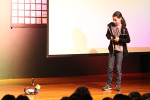 Eliana B. brings one of her robots onstage during ASM